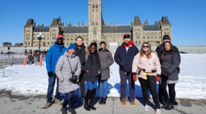 Work & Labour Studies students pose for group photo in front of Ottawa Parliament Building