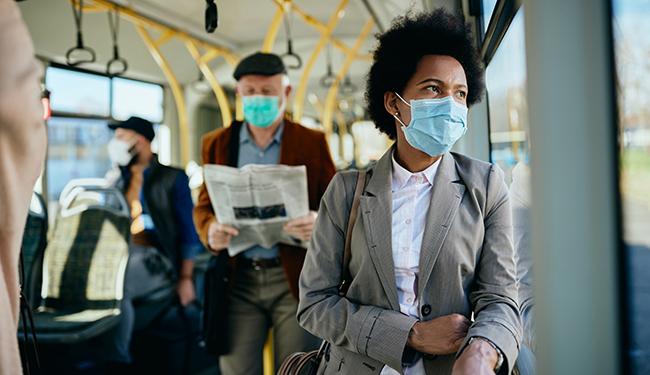 Transit bus riders wearing face masks during pandemic