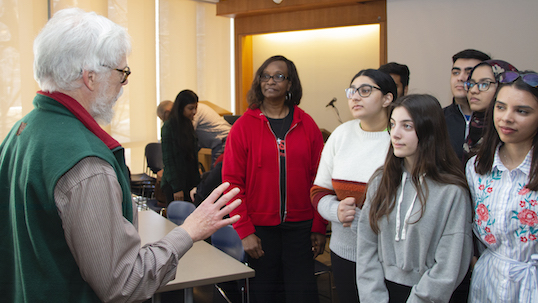 professor interacting with group of students