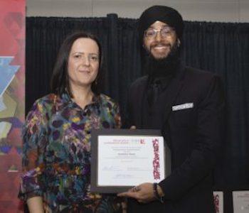 Sukhpreet Singh receiving award while standing next to Alena Kimakova