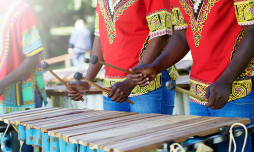 african drummers in traditional clothes