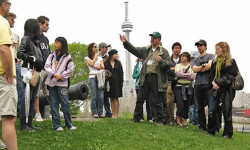 professor leading students on field trip to fort york in toronto