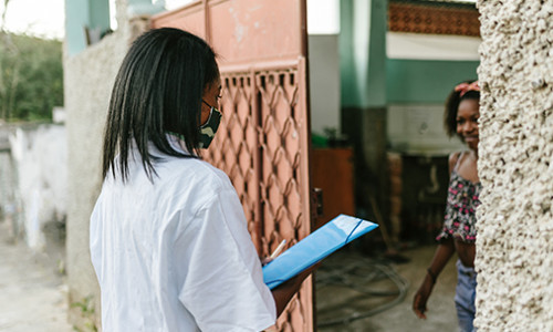 medical worker greeting person