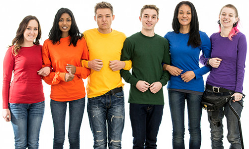 group of diverse people in pride coloured sweaters