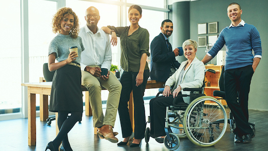a group of diverse people posing for equity inclusion