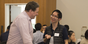 Dean & Professor JJ McMurtry meet a student in the Dean Circle