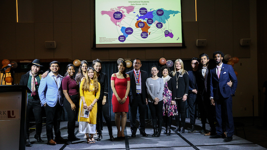 A wide shot of International students and professors at the International Student Awards