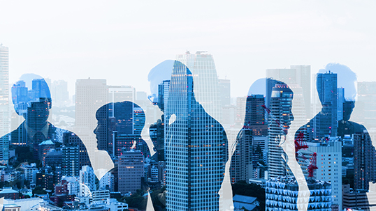 silhouettes of business people with office skyline in background