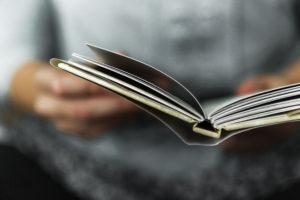 An open book being read