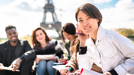 students studying in front of the Eiffel tower