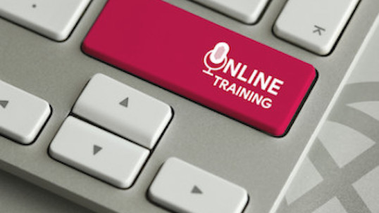 Red online training button on computer keyboard