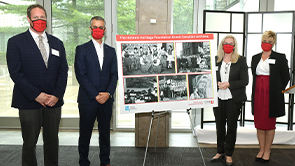 Dean JJ McMurtry and President Rhonda Lenton with HHF representatives as they present a poster highlight a donation from HHF.