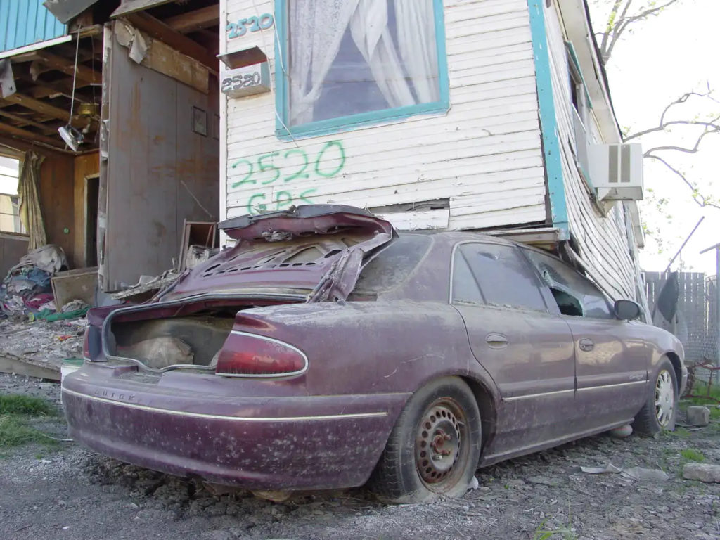 a damaged car and building