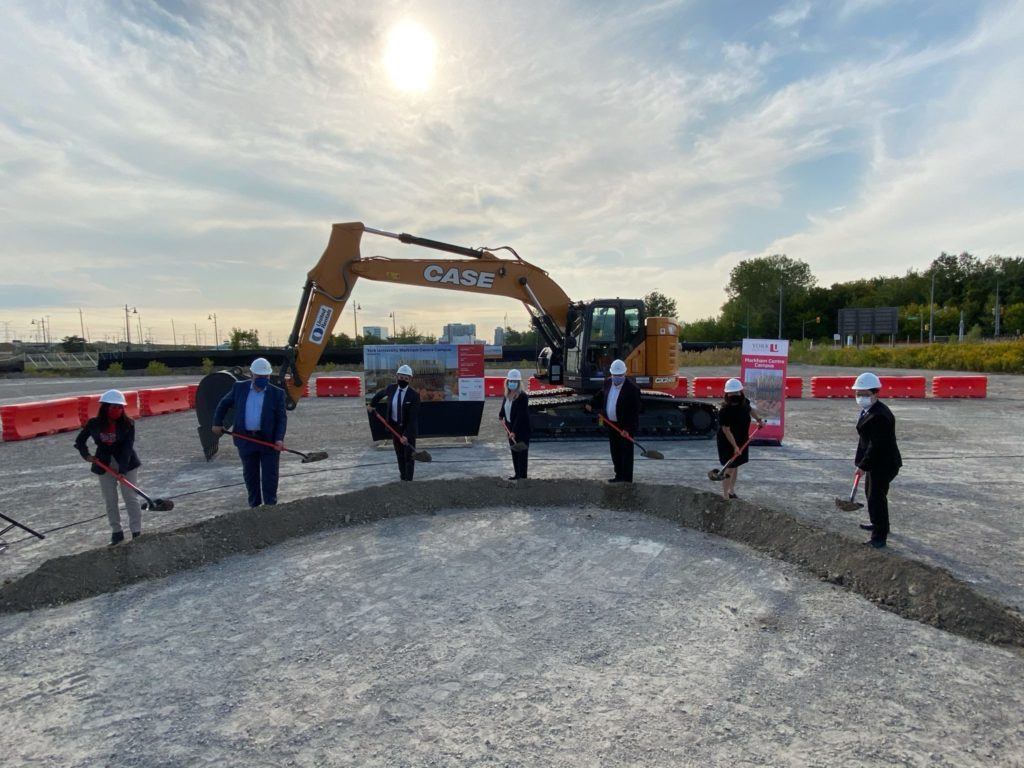 In September 2020, University community members joined representatives from local, regional and provincial governments for an official ground-breaking ceremony at the site for the new campus. The image shows people with shovels turning dirt in a ceremony.