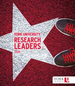 photo of white star on red background with York University Research leaders 2020 written inside star, looking down and seeing a pair of sneakers with red laces.
