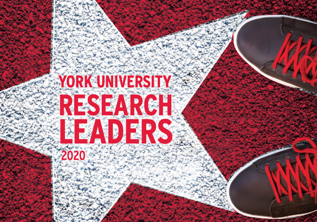"""white star with red background on pavement with """"York University Research Leaders 2020"""" written in it, with shoes standing beside it"""