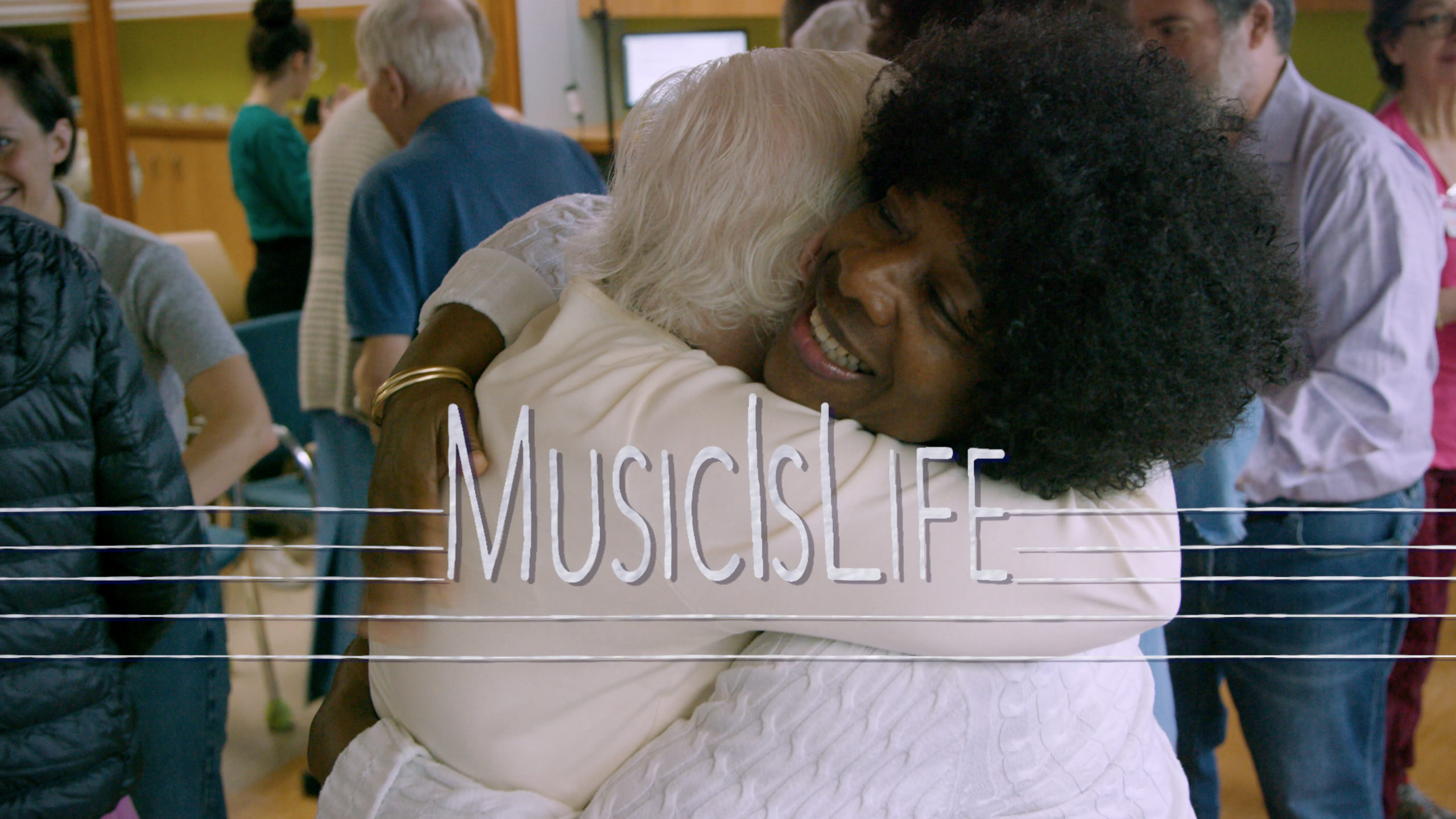 """two people hugging with the words """"Music Is Life"""" written overtop"""