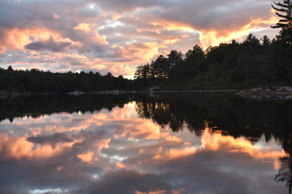 A sunset caught over Boundary Lake in Killarney Provincial Park. Photo by Amanda Liczner