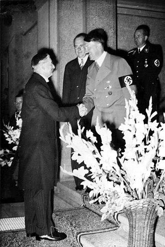 Neville Chamberlain greets Hitler in 1938