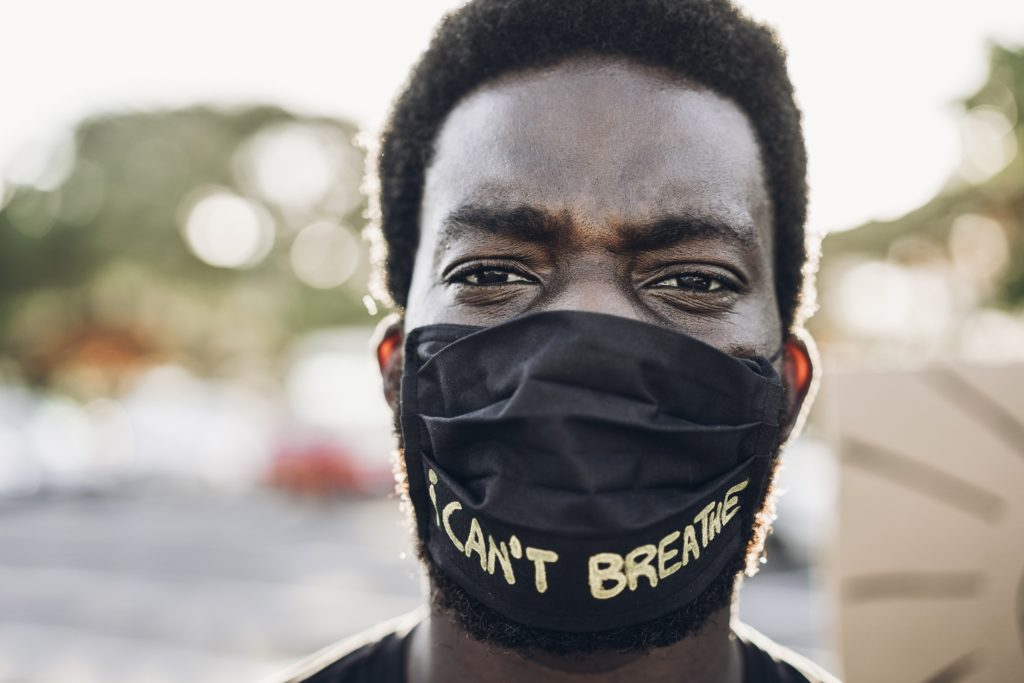 "Black man wearing mask ""I can't breath"""