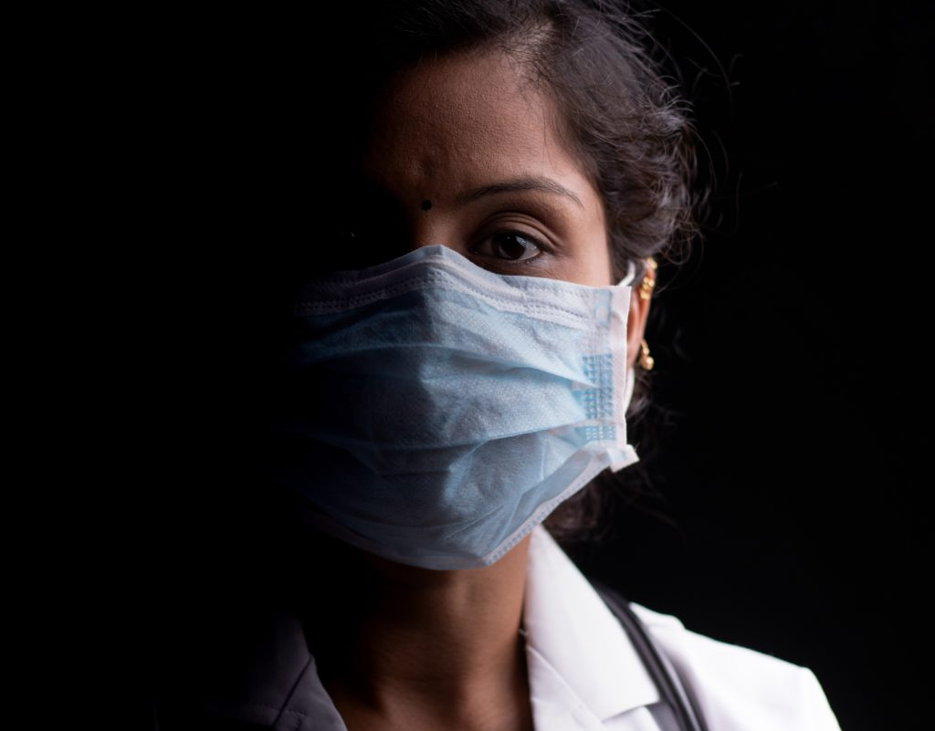Image of masked healthcare worker, female
