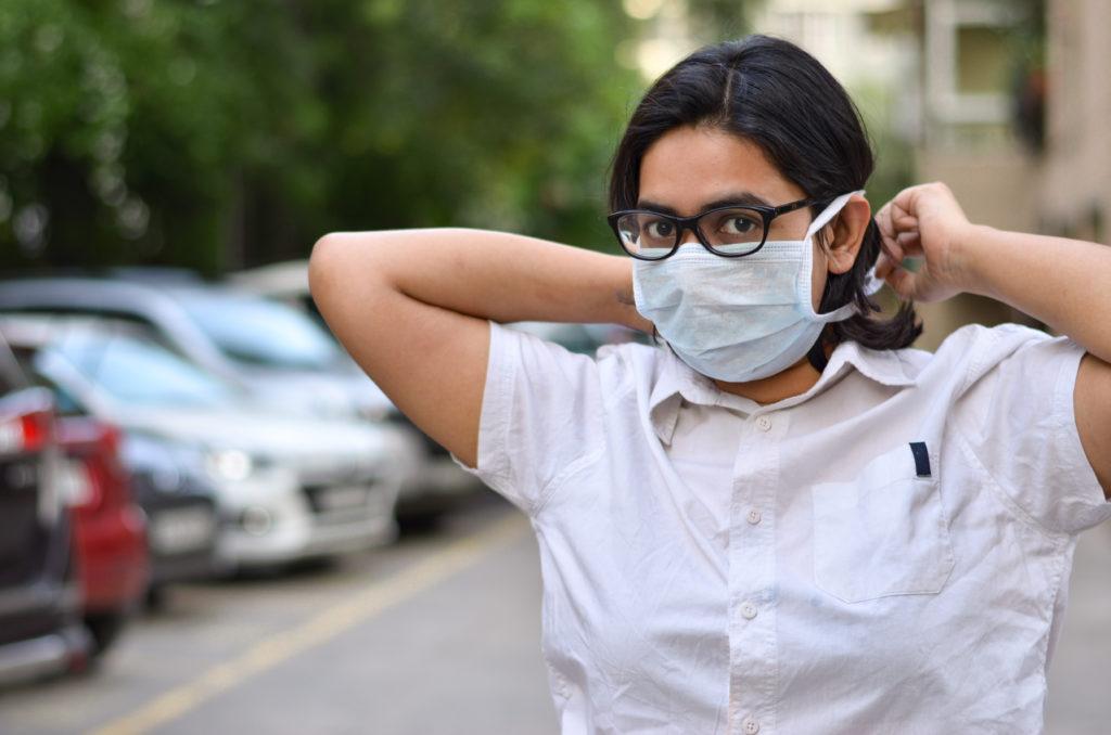 Nurse putting on mask