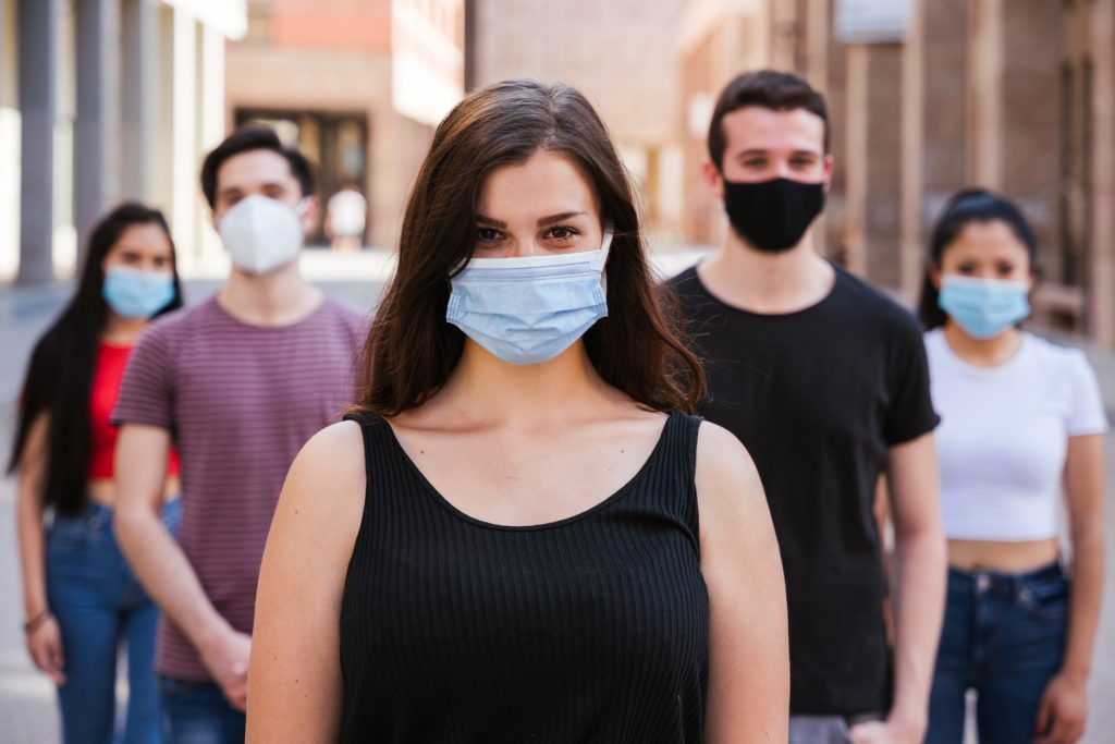 Row of people with masks on, women first