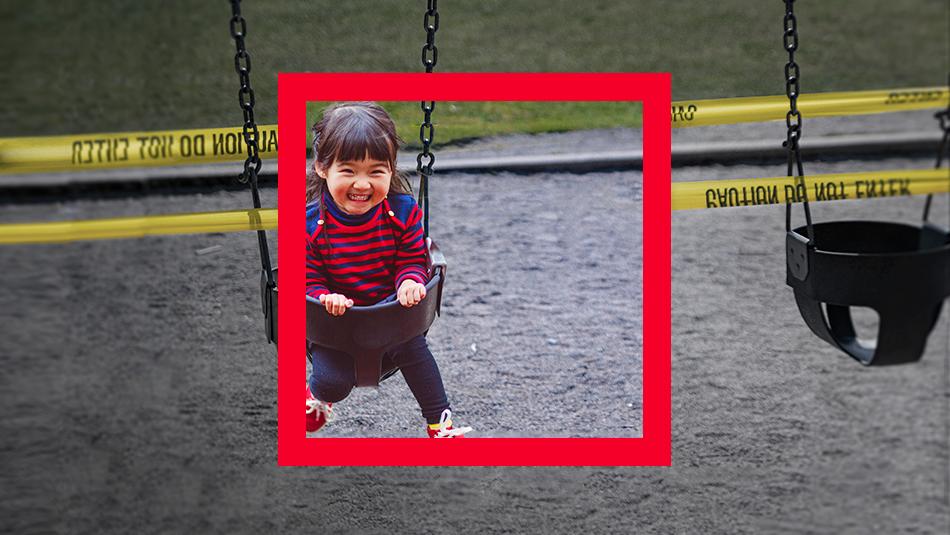 Little girls on swings