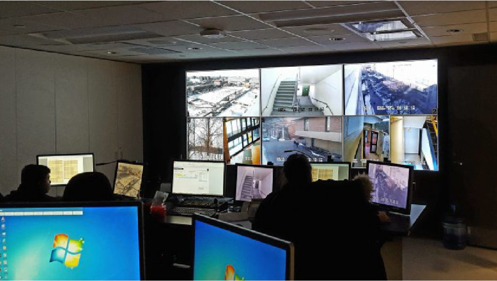 CCTV staff monitoring security camera's in their office