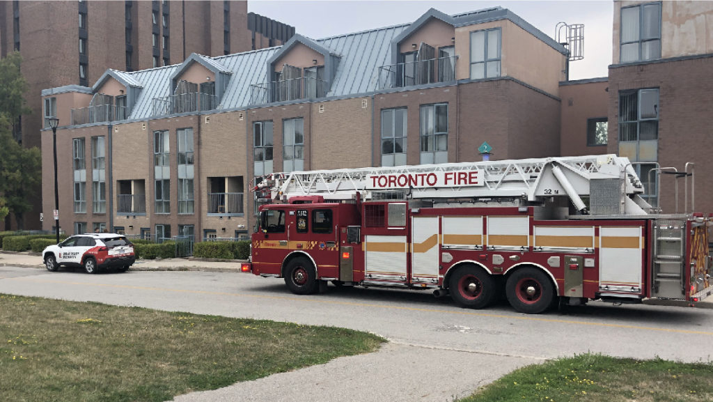 Security patrol vehicle escorting Toronto Fire Services to a residence