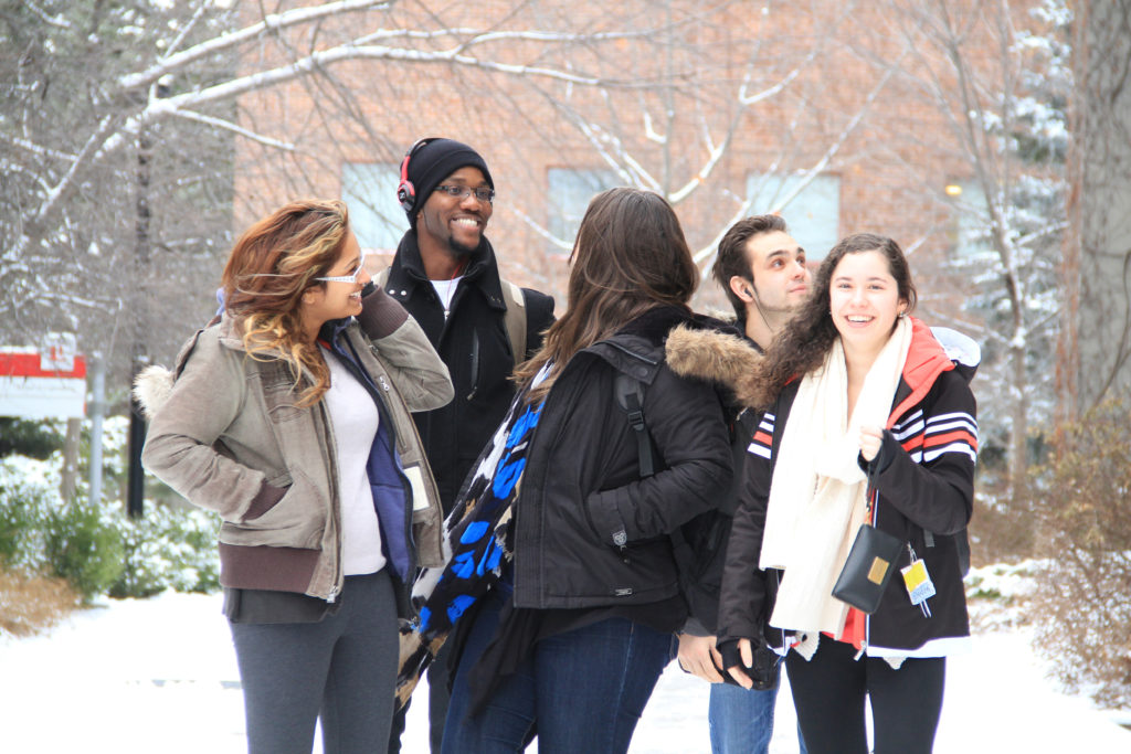 Students outside in the snow on campus