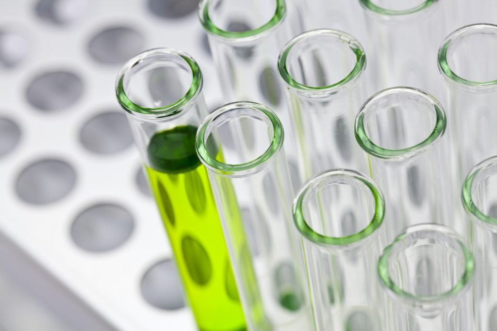 Chemistry bottles with green liquid