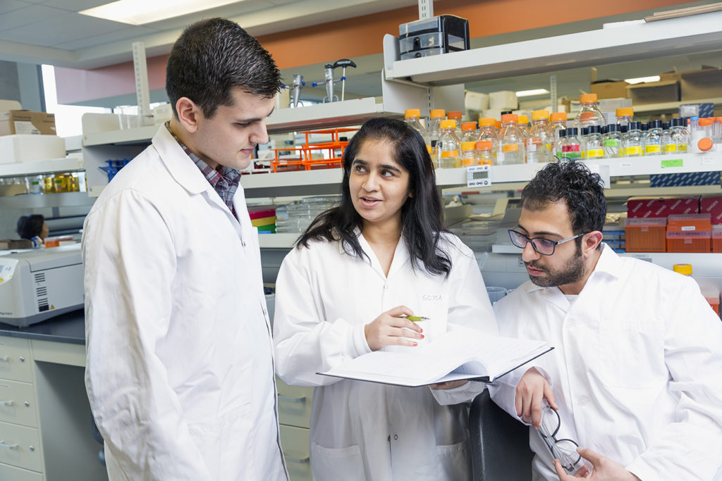 Three science students in a lab.