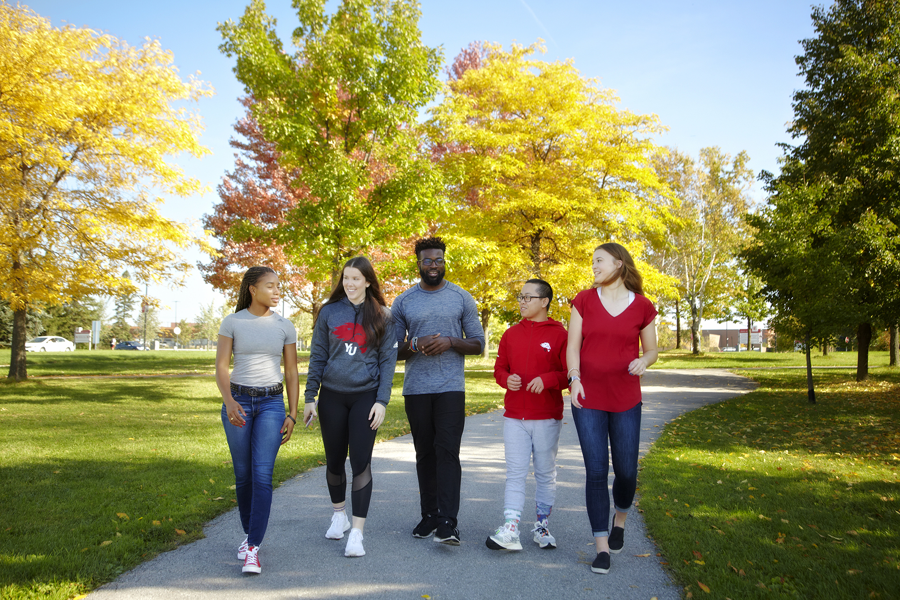 Students walking outside on campus
