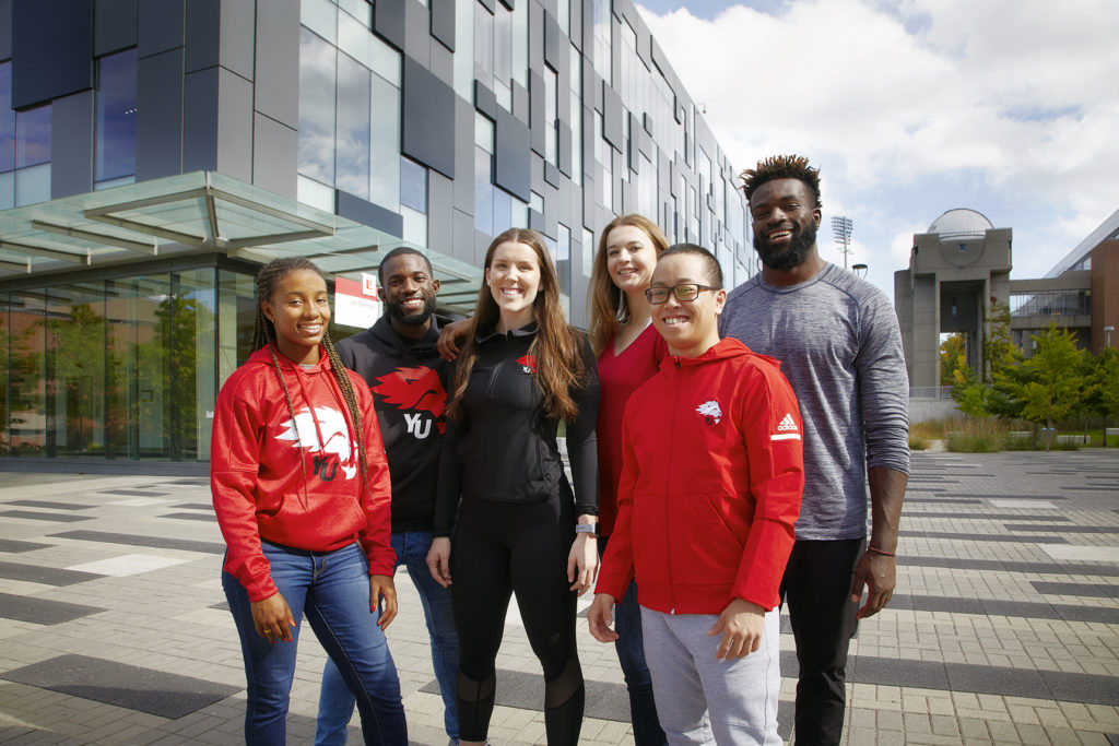 A group of six students outside the Life Sciences building on Keele Campus