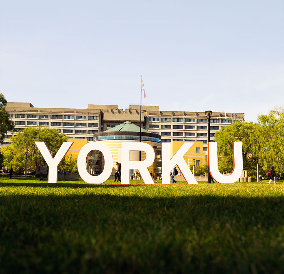 """Large letters spelling """"York U"""" are shown on the campus grounds."""